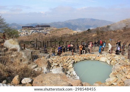 Hakone, Japan - April 9, 2015: Owakudani, a volcanic valley with active sulphur vents and hot springs, is popular for its scenic views, volcano activity and black eggs boiled in hot springs. - stock photo