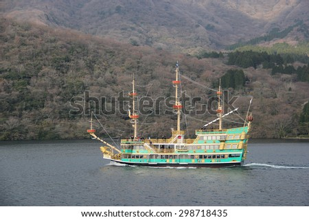 Hakone, Japan - April 9, 2015: The Hakone Sightseeing Cruise serves the 3 ports on Lake Ashi, a crater lake that lies along the southwest wall of the caldera of Mount Hakone, a complex volcano. - stock photo