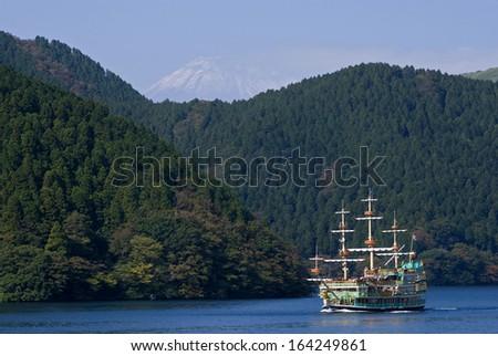 HAKONE, JAPAN - OCTOBER 30: Cruise on Lake Ashi with Mt. Fuji on October 30, 2013, Hakone, Japan. Fuji are is the most popular tourist spot in Japan. - stock photo