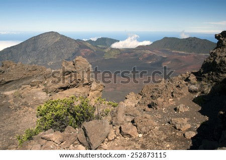 Haleakala National Park in Maui includes an ancient dormant volcano where visitors can hike around the rim or inside the crater. - stock photo