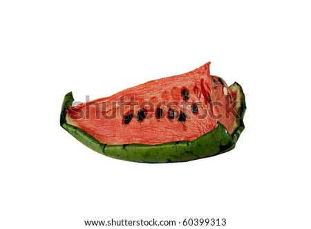 Half a dried up and dehydrated watermelon half isolated on a white background - stock photo
