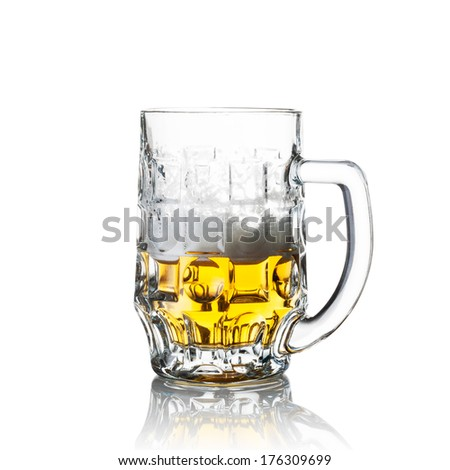 Half a glass of beer isolated on white - stock photo
