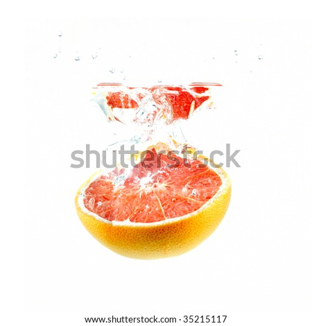 half a grapefruit falling into water