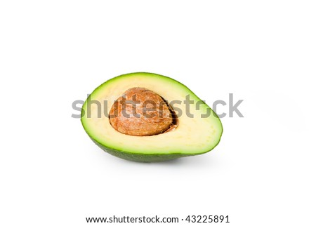 Half an avocado sliced open to reveal the pit