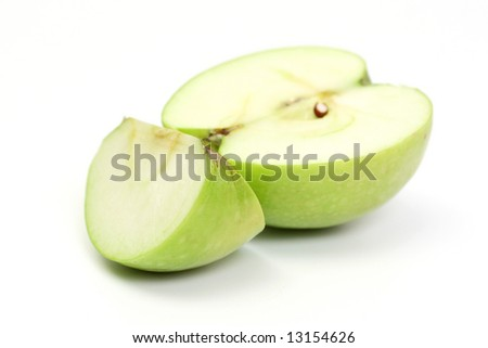 Half and slice green apple on white background - stock photo