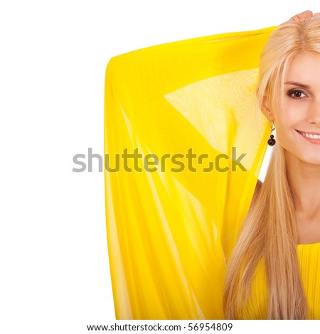 Half beautiful woman in yellow dress has lifted hands and smiles, it is isolated on white background.