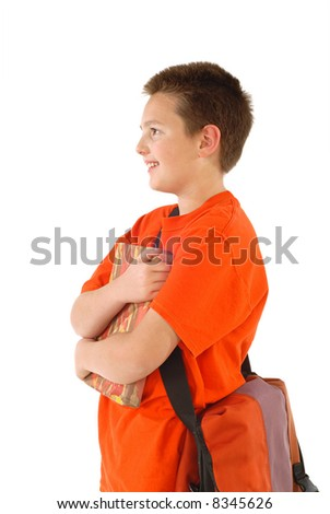 Half body shot of a student carrying a book and bring ready to learn - stock photo