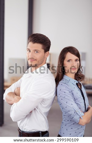 Half Body Shot of Confident Young Business Couple in Back to Back with Arms Crossed Over their Stomach, Looking Straight at the Camera. - stock photo