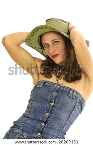 Half body view of young pinup model in cowboy country wear, with jeans dress and cowboy hat. Isolated on white background.