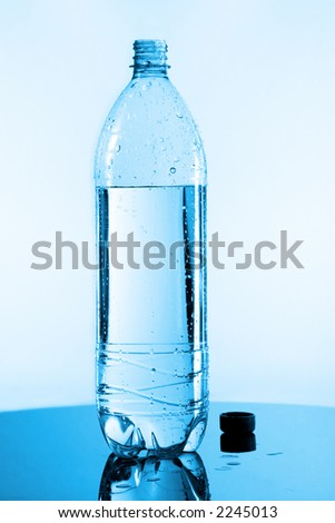 half bottle of water on glass - stock photo