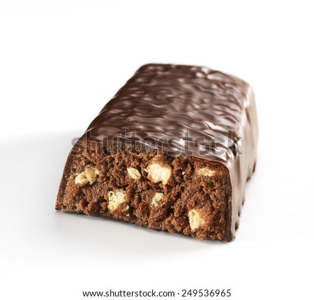 Half cereal bar of dark chocolate isolated on a white background - stock photo