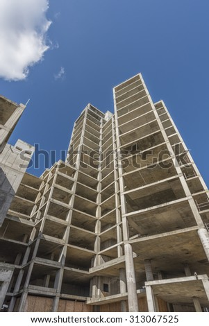 Half constructed apartment blocks towering up to the sky