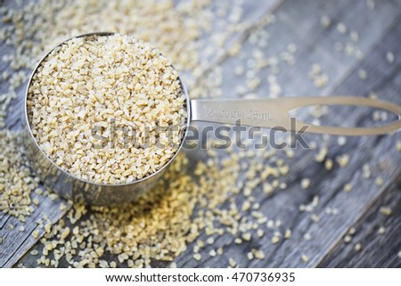 Half cup of raw bulgur wheat ready for recipe.