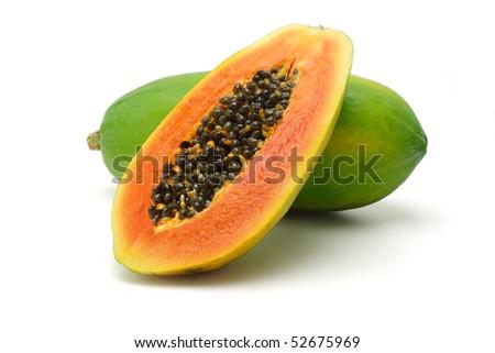 Half cut and whole papaya fruits on white background - stock photo