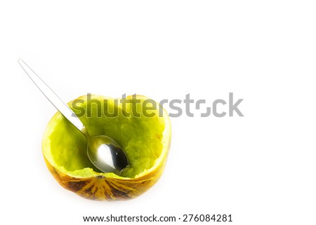 Half cut of ripe cantaloupe melon with spoon on white background - stock photo