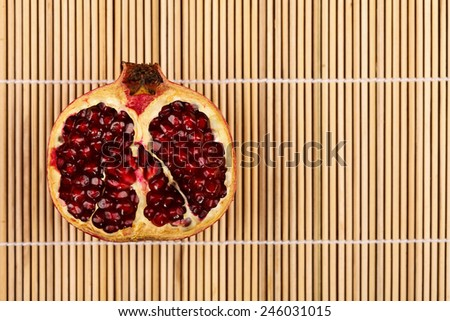 Half-cutted grenadine on narrow wooden sticks - stock photo