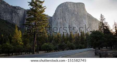 Half Dome, a giant rock, lit by the first light of the sun in Yosemite National Park, California, USA America - stock photo