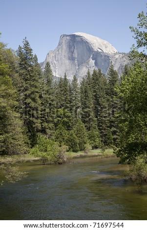 Half Dome from the Sentinel Bridge in Yosemite National Park. - stock photo