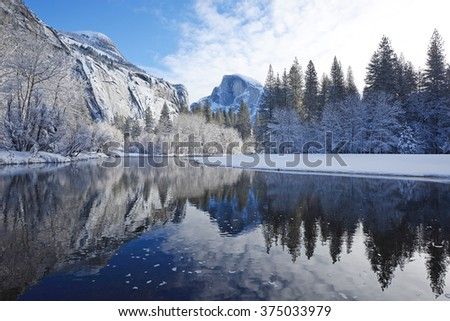 Half done reflection in winter - stock photo