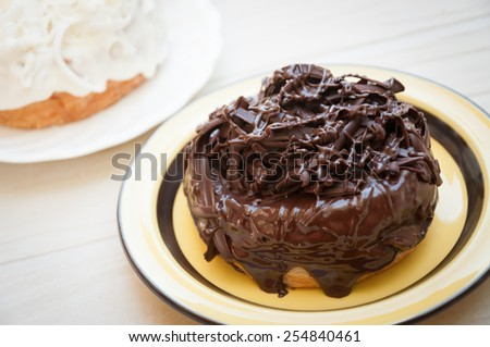 Half-donut and half-croissant pastries, chocolate, white chocolate, Traditional French puff doughnuts pastries with chocolate and topping, cronut - stock photo