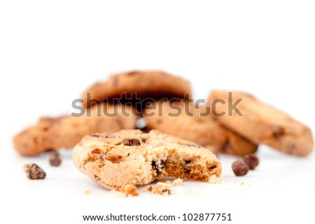 Half-eaten cookie in front of a stack of cookies against a white background
