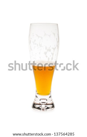 Half Empty Beer Glass With Foam On Glass - stock photo