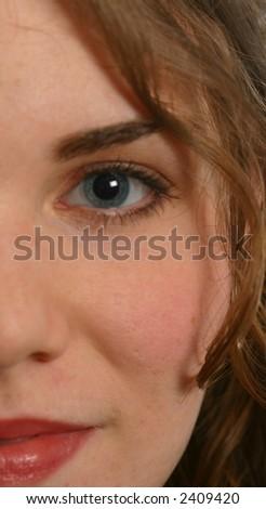 Half face, beautiful female - stock photo