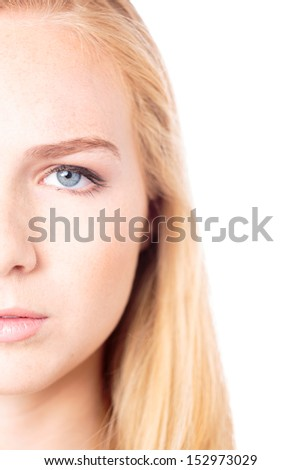 Half face closeup portrait of the eye of an attractive young woman with no makeup and a natural smooth complexion with long blond hair, isolated on white - stock photo
