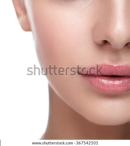 Half face female beauty portrait with healthy skin and Rose Quartz color lips