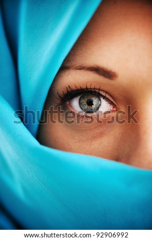 Half face in blue scarf - stock photo