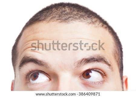Half face of a man looking to the corner, isolated on a white background - stock photo