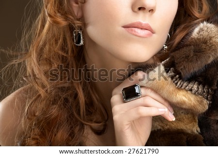 Half face of a young beautiful woman - stock photo