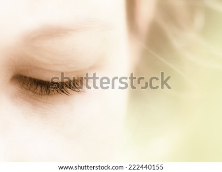 Half face of beautiful natural woman on background of green trees.  Vintage style. - stock photo