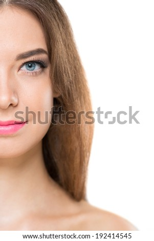 Half face of beautiful young woman with perfect skin - stock photo