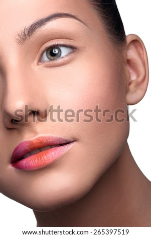 Half face of beautiful, young woman with pure skin with colorful lips makeup. Close up head shot