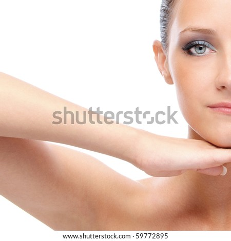 Half face of charming woman with bared shoulders, on white background.