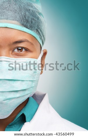 Half face of female doctor looking to camera