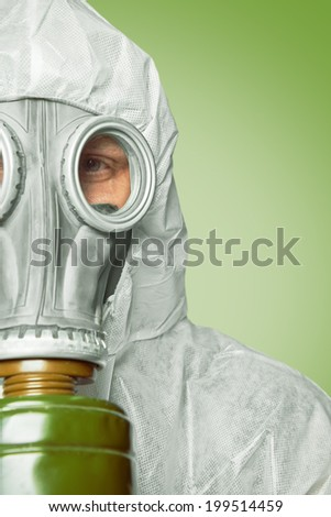 Half face of man in respirator and protective uniform, space for text - stock photo