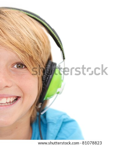 half face of smiling happy boy listening to music with earphones