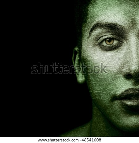 Half face of strange man with textured skin - stock photo