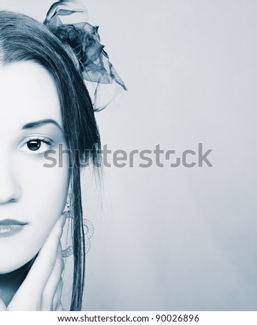 Half face of  young woman with bright visage. - stock photo
