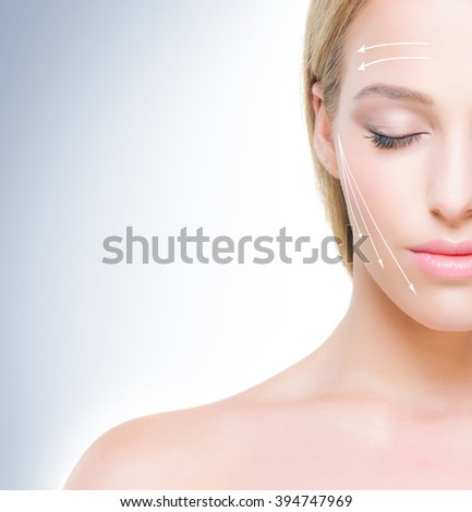 Half face portrait of beautiful girl with pure and smooth skin. Face lifting concept. - stock photo