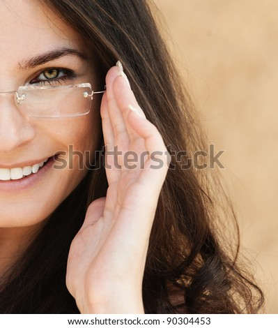 half face sexy brunette beautiful woman with long hair wearing glasses - stock photo