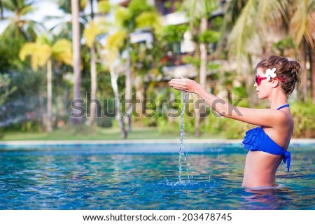 half face view of fit woman in luxury spa pool - stock photo