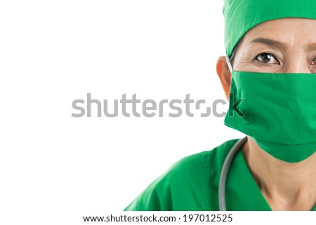 Half-faced portrait of Asian female doctor in protective mask - stock photo