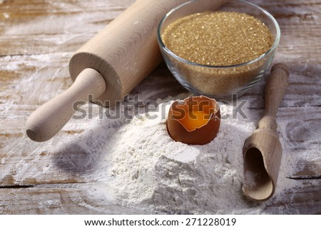 Half finished products of flour egg and brown cane sugar for baking, horizontal picture - stock photo