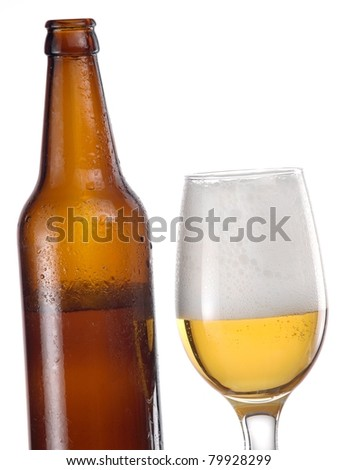 Half full glass with beer and a brown bottle