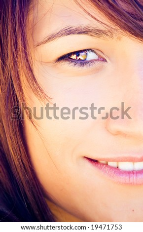 Half full portrait of a smiling woman.