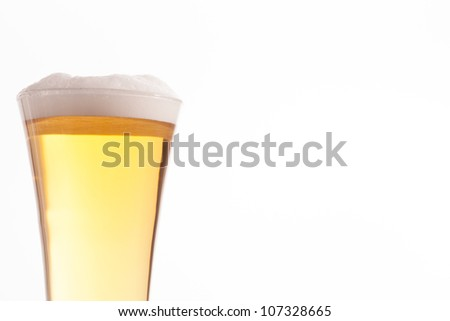 Half glass full of glass and foam against a white background