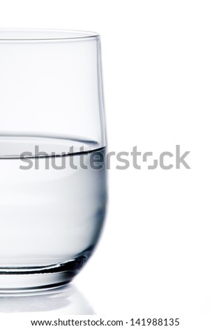half glass of pure water with space for text on white background - stock photo